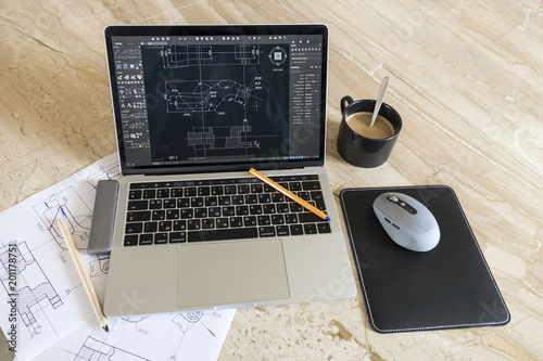 Photo laptop with blueprints mechanical work desk
