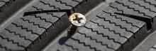 Metal Screw In Damaged Tyre Before Repair