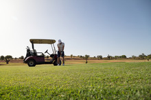 Golfer And Golf Cart