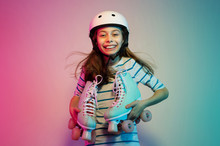 Young Child Girl In Safety Helmet With Roller Skates - Sports