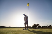Golf Player Near Flag Pole Hol...