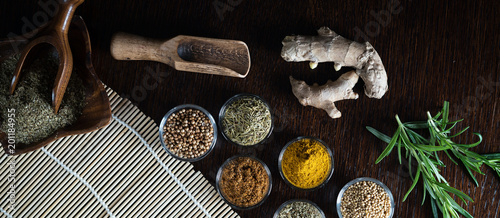 Variety of dry and fresh spices and herbs on table.