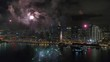 Stunning colorful fireworks exploding in dark night sky in bright illumination cityscape skyline background