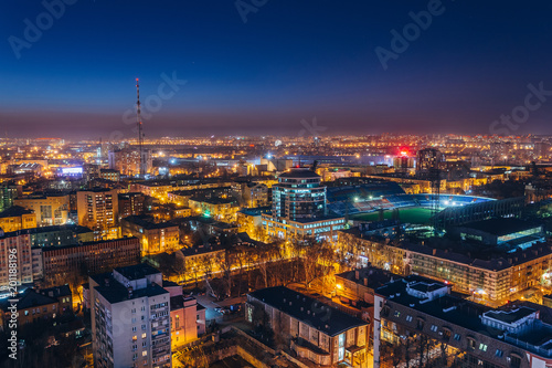 Fototapeta Aerial view of night Voronezh downtown. Voronezh cityscape at blue hour. Urban lights, modern houses, television tower, stadium obraz na płótnie