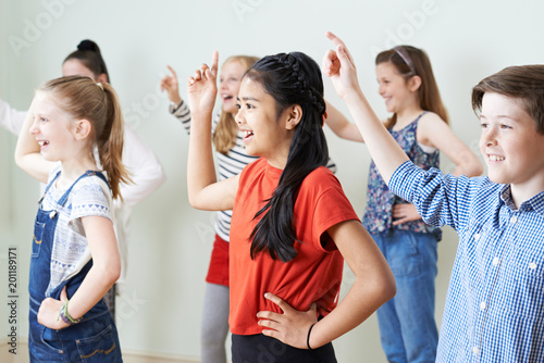 Stampa su Tela Group Of Children Dancing In Drama Class Together