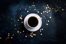 Cup Of Coffee And Stars On A Dark Blue Background. Concept Of The Starry Sky And Coffee. Flat Lay, Top View