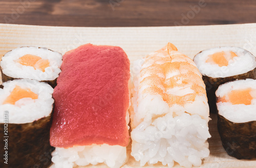 Sushi, a typical Japanese food prepared with a base of rice and various raw fish. To which is added, according to the variants, the nori algae, cheeses and avocados. #201203178