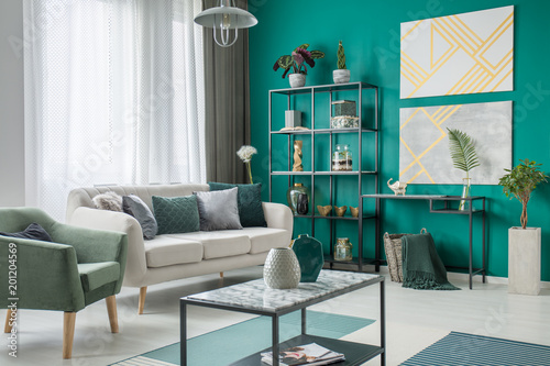 Foto op Canvas Bossen Bright sofa in green room