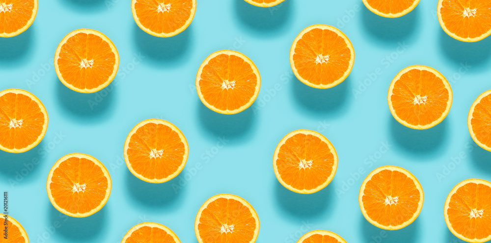 Fresh orange halves on a blue background