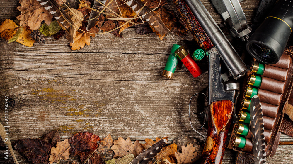 Fototapeta Hunting equipment on the wooden background. Hunt concept.