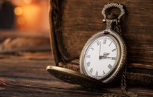 Old Pocket Watch On The Wooden...