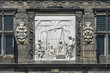 Relief on the facade of the Waag (weigh house) depicting the weighing of cheese in Gouda, Netherlands
