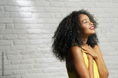 Fotografie, Obraz  Facial Expressions Of Young Black Woman On Brick Wall