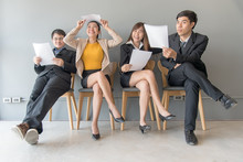 Job Interview. Group Of Asian People Review Document While Waiting For Job Interview. Business Concept