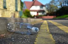 Discarded Plastic Bottle Lying...