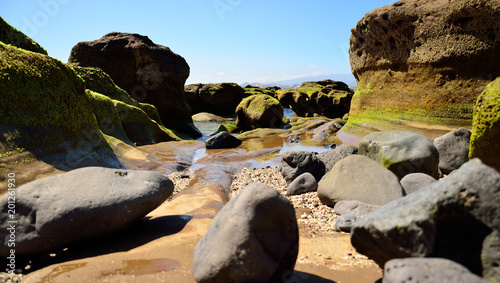 Poster Kust Rocky coast at low tide, The confital, Gran canaria, Canary islands