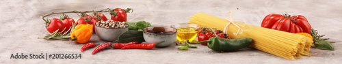 Fototapeta Italian food background with different types of pasta, health or vegetarian concept. obraz