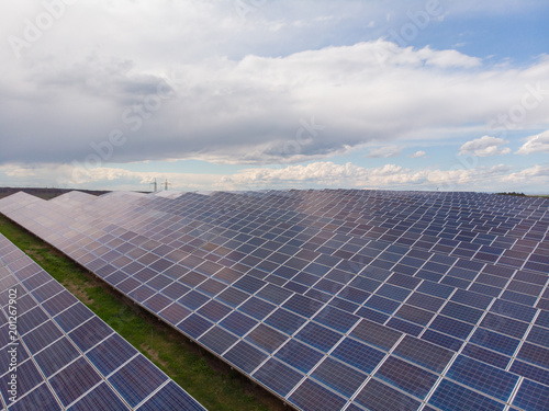 Aerial view industrial Photovoltaic solar units panels environment producing renewable green energy