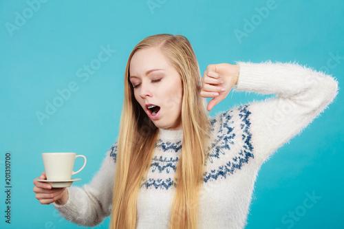 Fototapeta Sleepy woman holding cup of coffee