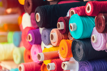 colorsful fabric silk rolls in textile shop industry from india