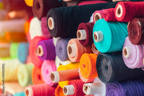 Leinwand Poster colorsful fabric silk rolls in textile shop industry from india
