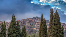 Panoramic View Of A Beautiful Mountain Village Named Dimitsana Under A Dramatic Sky And Fog, Peloponesse, Greece