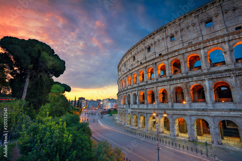 Poster Rome Colosseum. Image of famous Colosseum in Rome, Italy during beautiful sunrise.