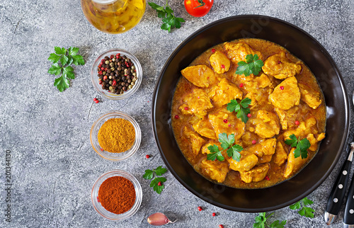 Curry with chicken and onions. Indian food. Asian cuisine. Top view