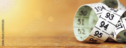 Obraz Weight loss, diet concept - web banner of a measuring tape with blank, copy space - fototapety do salonu