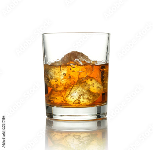 Glass of scotch whiskey and ice on a white background.