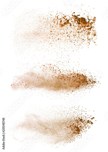 Fotografía  Abstract colored brown powder explosion isolated on white background