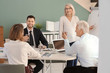 Group of people discussing ideas at table in office. Consulting service concept