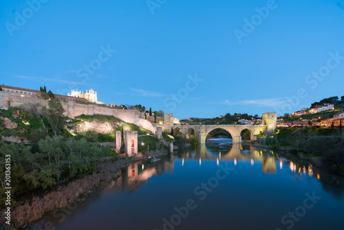 Keuken foto achterwand Turkoois Panoramic cityscape of Toledo with San Martin's Bridge at night near Madrid, Spain