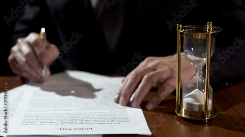 Terminally ill man signing living will before medical care, leaving heritage Tablou Canvas