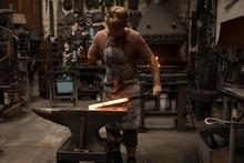 Blacksmith Hammering A Hot Metal Rod