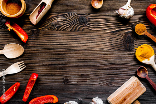 Photo  cook work with kitchenware set on dark background top view mock