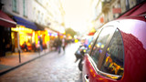Fototapeta Uliczki - Closeup of car parked on narrow street, traffic violations, tourist route