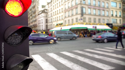 Fotografiet Red light for street traffic, pedestrian crossing road, rush hour in daytime