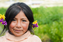 Beautiful Native American Little Girl With Flowers In Her Hair.