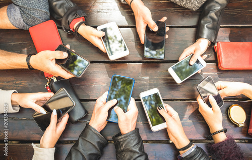 Obraz People group having addicted fun together using smartphones - Detail of hands sharing content on social network with mobile smart phones - Technology concept with millennials online with cellphones - fototapety do salonu