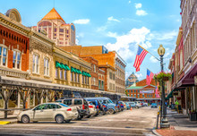 Small Town Main Street USA Hometown Vintage Commercial Downtown Storefronts With Flag Roanoke
