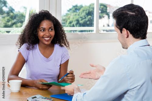 Fotografie, Obraz  Junge Frau beim Bewerbungsgespräch