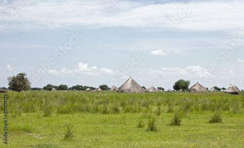Village with grass huts on the plains of South Sudan.