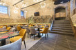 canvas print picture - Interior of a modern hotel restaurant with brick wall