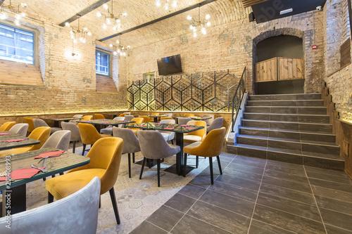 Fotobehang Restaurant Interior of a modern hotel restaurant with brick wall