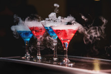 Blue And Red Cocktails With Th...