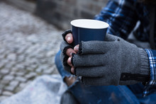 Beggar Holding Disposable Cup