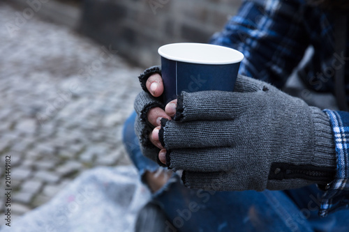 Beggar Holding Disposable Cup Fototapeta