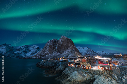 Foto auf Gartenposter Nordlicht Fisherman village with Aurora in the background / travel concept world explore northern light