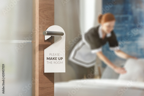 Housemaid cleaning up room Canvas Print